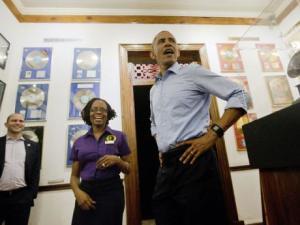 Mr. Obama's visit Bob Marley Museum showing his dance moves.
