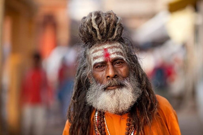 old shaman in Southern Asia with dreadlocks