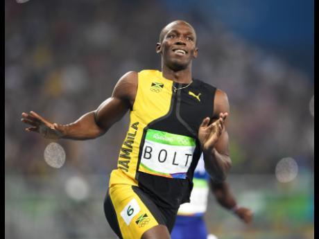 Usain Bolt on his way to gold