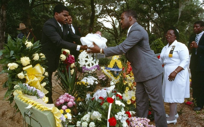 Passing a child over grave, Jamaican funeral traditions