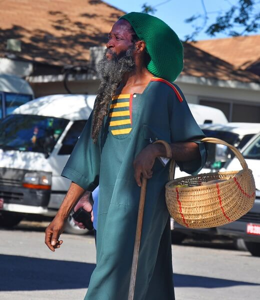 Rastafarian man carrying a basket
